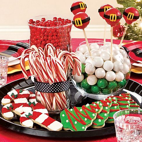 A sweet centerpiece for a Christmas cookie exchange party! Fill clear vases with candy, display on a tray, and decorate with holiday cakepops and cookies. Click for more cookie party ideas!