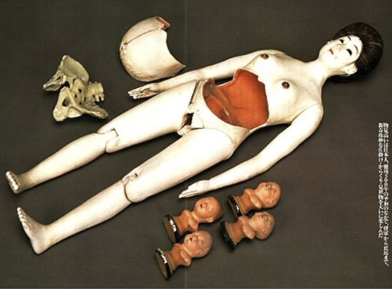 Japanese pregnant woman doll. These were manufactured throughout the 1700s and 1800s. Sold at carnivals as toys and also as mid-wife instructional aids. Love that removable pelvis!
