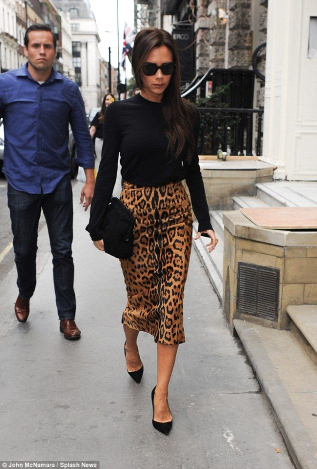 Victoria's outfit today was slightly more demure than her bold leopard print pencil skirt that she wore on her first trip to the store on Saturday