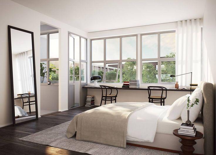 Prosta #sypialnia z białymi ścianami i ciemną podłogą. Odpowiednia dla osoby, która oprócz zrelaksowania się na dużym łóżku, lubi poczytać przy biurku z widokiem na zieleń.