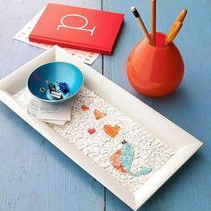 Mosaico com casca de ovo e figurinhas