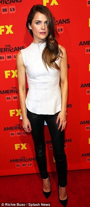 Keri Russell in black fitting leather pants and white sleek peplum top, complete with black pointed stilettos - love the color contrast and hair style.. at screening of the new TV series, The Americans in New York.