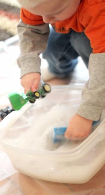 Basic water activity - washing toys.