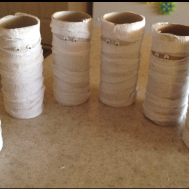 Mummy hunt for a toddler Halloween party :) made from toilet paper rolls, white streamers, and googly eyes...