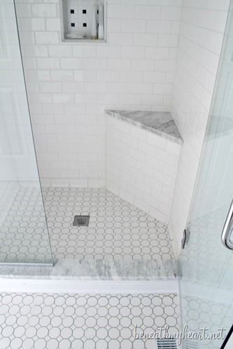 Love this shower -- especially the little corner seat.  Would use crema marfil marble and ivory-colored tile in mine!