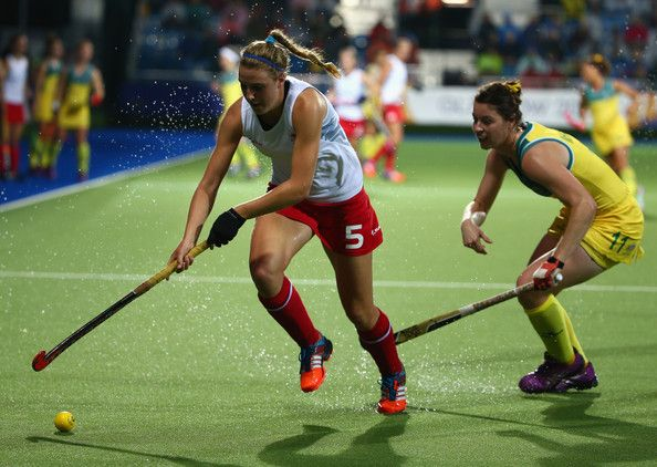 Lily Owsley Photos Photos - Lily Owsley of England controls the ball during the Women's Gold Medal Match at Glasgow National Hockey Centre during day ten of the Glasgow 2014 Commonwealth Games on August 2, 2014 in Glasgow, Scotland. - 20th Commonwealth Games: Hockey