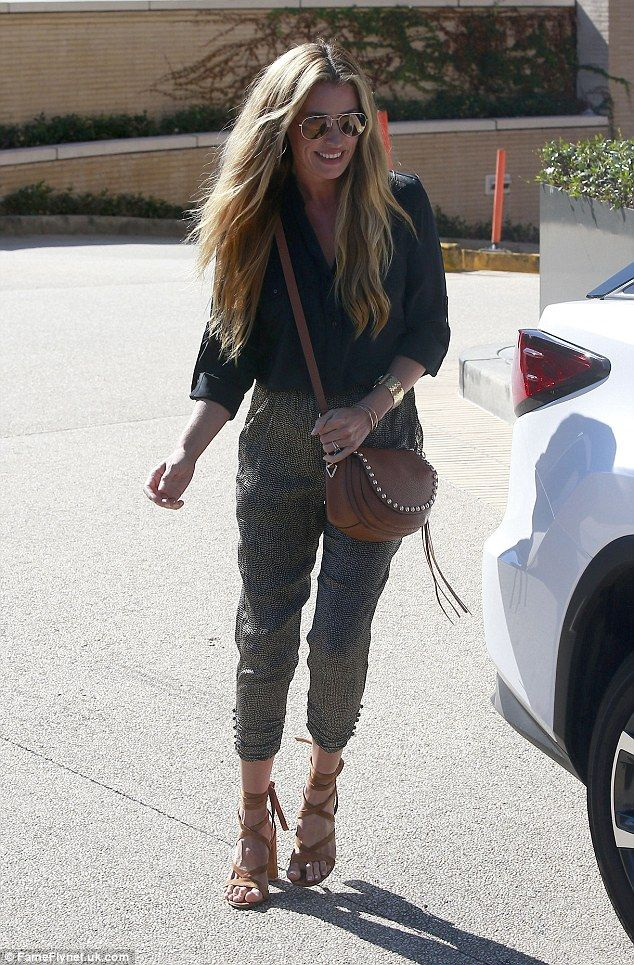 Style queen:Cat Deeley, 39, looked chic as ever in leopard print capri pants while out shopping with husband Patrick Kielty in LA on Thursday