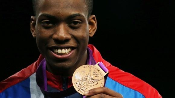 In taekwondo, Britain's Lutalo Muhammad, 21, earned himself a bronze medal