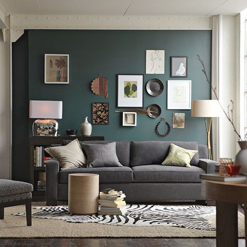 Dark teal colored accent wall in living room with grey for Living room accent wall ideas