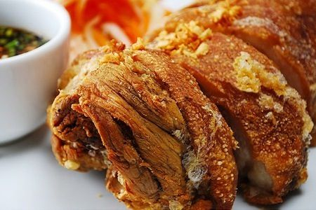 CRISPY PATA is a famous Filipino pork dish that uses a whole pig's leg. The leg (or pata) is made tender by simmering in water along with other spices. It is then rubbed with seasonings and deep-fried until the texture becomes very crunchy.