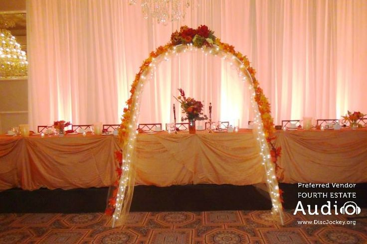 A lovely lighted altar provides a beautiful backdrop for Caitlin and Andrew's wedding ceremony at Drury Lane,.