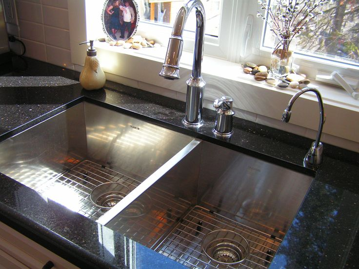 modern sink faucet complemented by our black galaxy