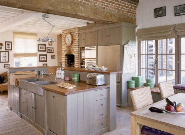 modern farmhouse kitchen white walls gray cabinets brick and beams