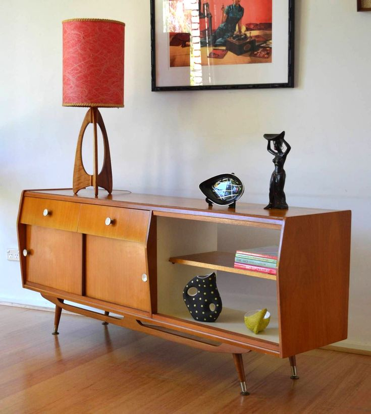 I'm partial towards teak so this MCM Danish Credenza got my attention - but what makes this is the atomic-style rocket lamp. Yes!