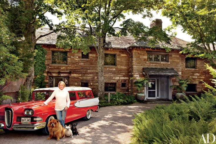 Martha Stewart with her Chow Chow Ghenghis Khan and French bulldogs Sharkey and Francesca alongside a 1958 Edsel Roundup at her Maine residence, Skylands, a '20s masterwork designed by architect Duncan Candler for the car's namesake, Edsel Ford, and his wife, Eleanor. Kevin Sharkey of Martha Stewart Living assisted with the decor.