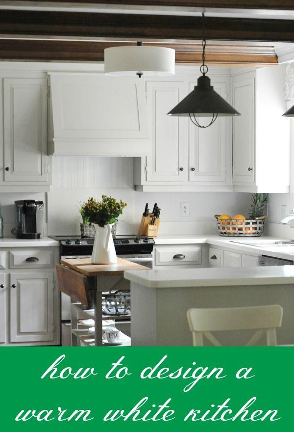 How to design a warm white kitchen via for Warm kitchen designs