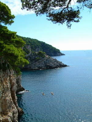Kayaking past the soaring sea cliffs of Croatia's Kolocep Island