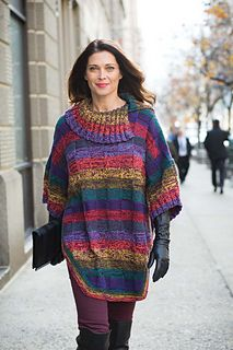 Knit in a festival of colors, a split-neck poncho is a go-with-everything three-season favorite. Loose and roomy, it drapes just so in double-stranded Heritage 150 from Cascade Yarns. Knit/purl basketweave patterning worked throughout texturizes the marled stripes, which are created by holding a dark plum strand together with a rainbow of other shades. The wide sleeves are picked up and knit after the shoulders are seamed. Multicolor garter-stitch borders finish the look.