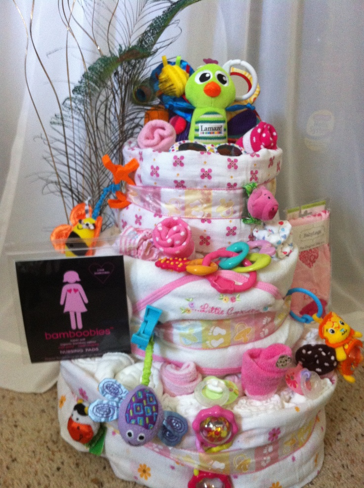 Peacock themed diaper cake with cloth diapers