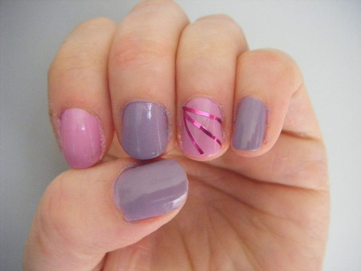 Meredith with a feature stripe-tape nail