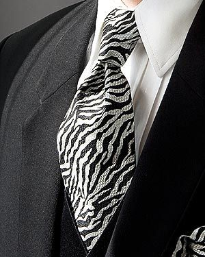 All the guys are wearing bright colored ties that match their chucks but my groom is gonna wear a black and white zebra tie with his black and white chucks. =)