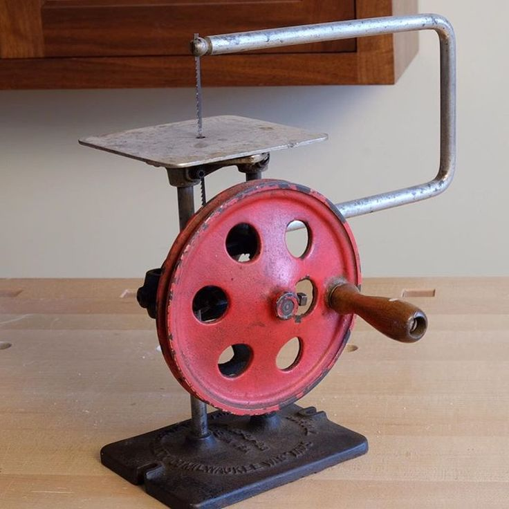 This is the first of two photos that I'll post of a nifty little hand cranked scroll saw I found in Chris Gochnour's shop. It's quite small, as the table is just bigger than the palm of my hand. It still works, and Chris has it running smoothing. It's beautiful.