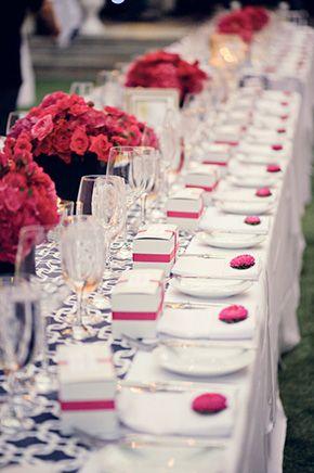 fuschia wedding flowers. photo by hoffmannphotographer.com; table decorations; favours