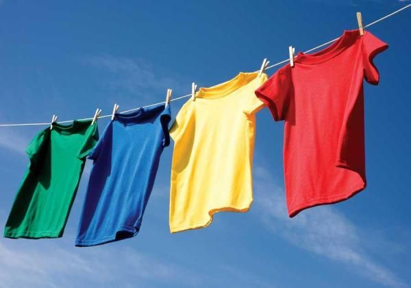 Save money — build our simple outdoor clothesline and let the sun dry your laundry! (If you don't have the space, consider retractable clotheslines or clothes drying racks instead.)data-pin-do=