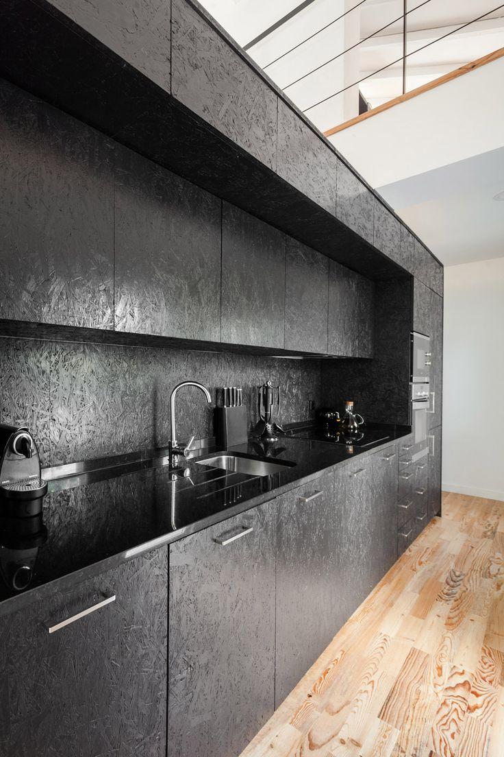 Black OSB Kitchen / Inês Brandão installs black box of rooms inside converted barn