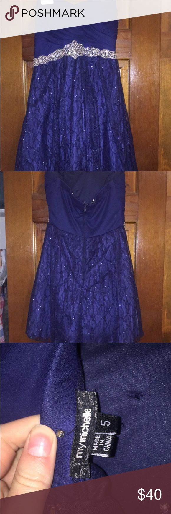 NAVY BLUE SHORT HOMECOMING DRESS The actual color is a very dark navy, however shows up lighter w flash Only worn once like 3 yrs ago Size 5 Little pieces of where i added straps (shown in last pic) but tore off Beautiful silver sparkly belt (attatched) with a sparkly lace skirt In wonderful condition!! PRICE IS NEGOTIABLE!! Dresses Mini