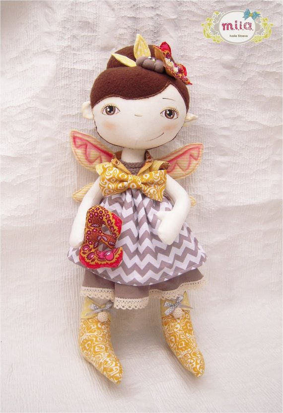 Elena's doll, bright fairy fabric doll with handpainted face holding E letter. $150.00, via Etsy.