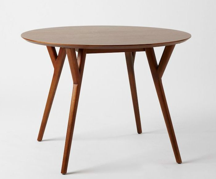 The Parker Mid-Century Round Dining Table is made of FSC-certified eucalyptus with a walnut veneer top; $599 from West Elm.
