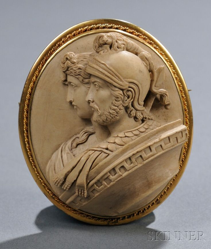 Antique Carved Double-Portrait Lava Cameo Brooch Depicting Mars and Venus In High Relief And Wearing Classical Roman Dress, Set Within A Gold-Tone Metal Mounting - Italy   c. 2nd Half 19th Century