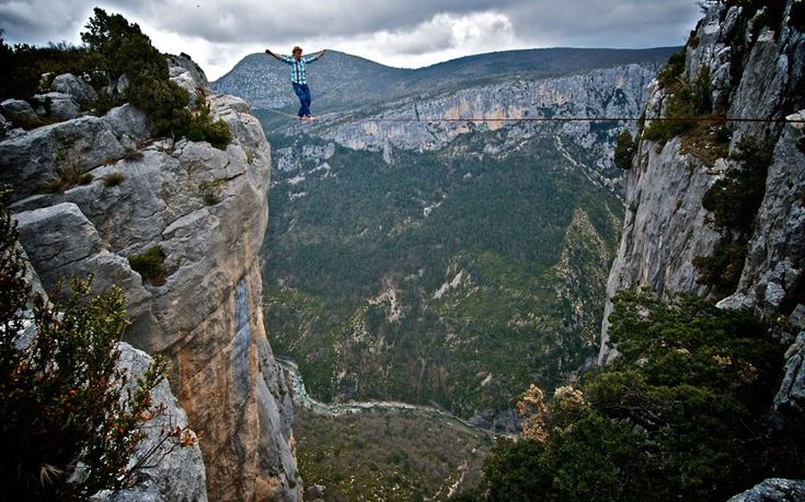 Daredevil Mich Kemeter, 23, walks across a tight rope without any safety harness above the Verdon Gorge in the South of France. Mich battled gusts strong enough to knock him off balance as he quickly hot-footed it 65ft to the other side.  Picture: Pedro Pimentel / Barcroft Media Oct 2012
