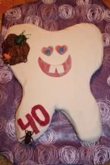 Tooth cake with cavity and sugarbugs
