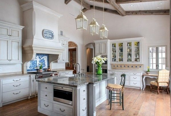 Mediterranean ideas white cabinets ceiling beams wood floor pendant lamps