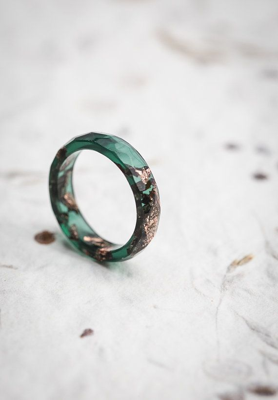 This dark jade moss green faceted transparent ring is made from high quality eco resin. The ring contains sparkled imitation rose gold flakes. This