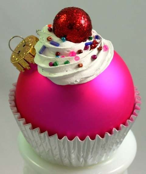 cupcake ornament - ball ornament, foil cupcake liner, tiny jewelry beads, crafting snow for icing, and a small red ornament or berry. so cute!