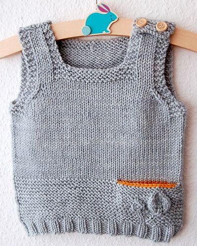The Petites Feuilles Vest is an easy, fun knit that is perfect for layering. With its adorable constrasting secret pocket (optional), it's also great to use up leftover yarn and it lends itself to many color combinations. The shoulder buttoning ensures that the garment is easy to put on and off.