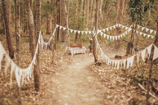Hannah and Simon's Outdoor Bush Wedding Could line path with pictures