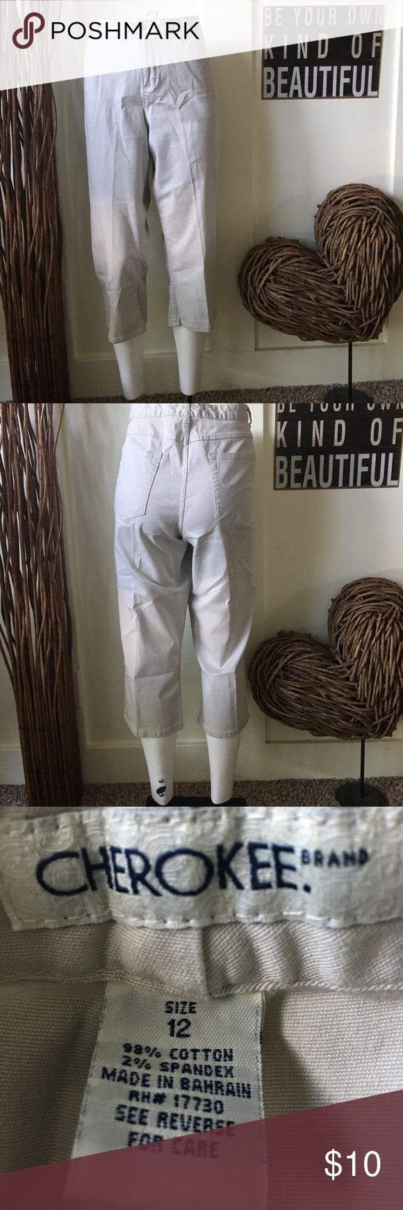 Cherokee brand cropped  khaki pants Cherokee brand cropped khaki pants have high-rise, wider leg and a bit of spandex for a comfortable fit.  inseam is approximately 22 inches Cherokee Pants Ankle & Cropped