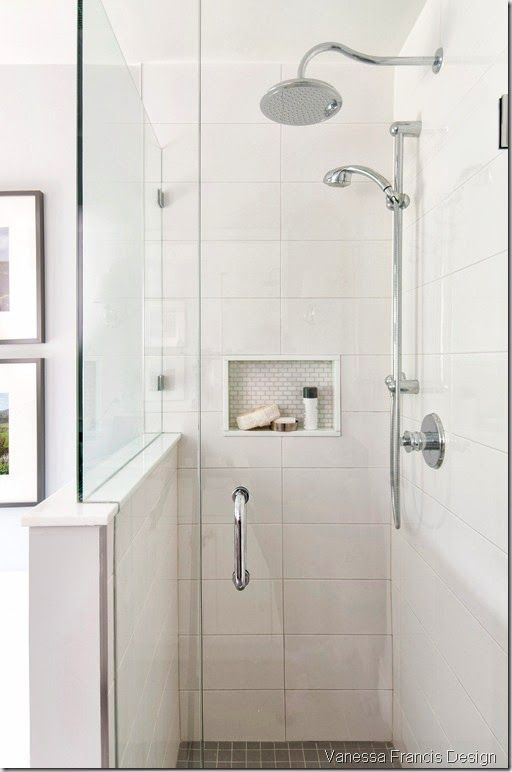 narrow walk-in shower w/ half wall + glass enclosure; darker tile on floor hides dirt; bright tile to ceiling bounces light; in-wall cubby for toiletries = win
