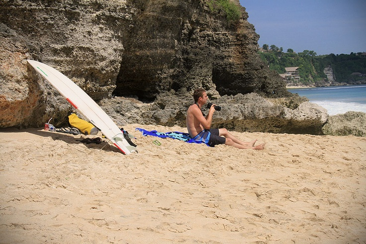 A surf board and a camera is all you ever need to enjoy the splendors of Dreamland Beach.