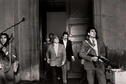 1973. A few seconds before Chile 's elected president Salvador Allende is dead during the coup.