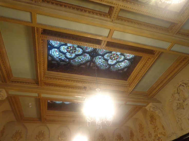 Philharmonic Dining Rooms, Photograph taken of the dining halls chandelier, and ceiling stained glass window.