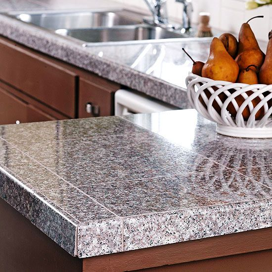 Tile Granite Countertops-Granite is generally installed in stone slabs with few or no visible grout lines. This can be very expensive -- both for the material and the labor to install such large, heavy pieces. One budget-friendly countertop option is using granite tiles, shown here.