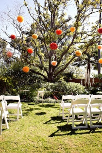 really pretty wedding ceremony outside:) so bright and sunny! those latern looking things really brighten the space outside