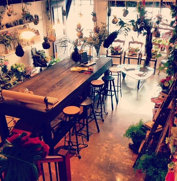 Cute florist shop - get a towel holder and stick it on the table for flower wrap!