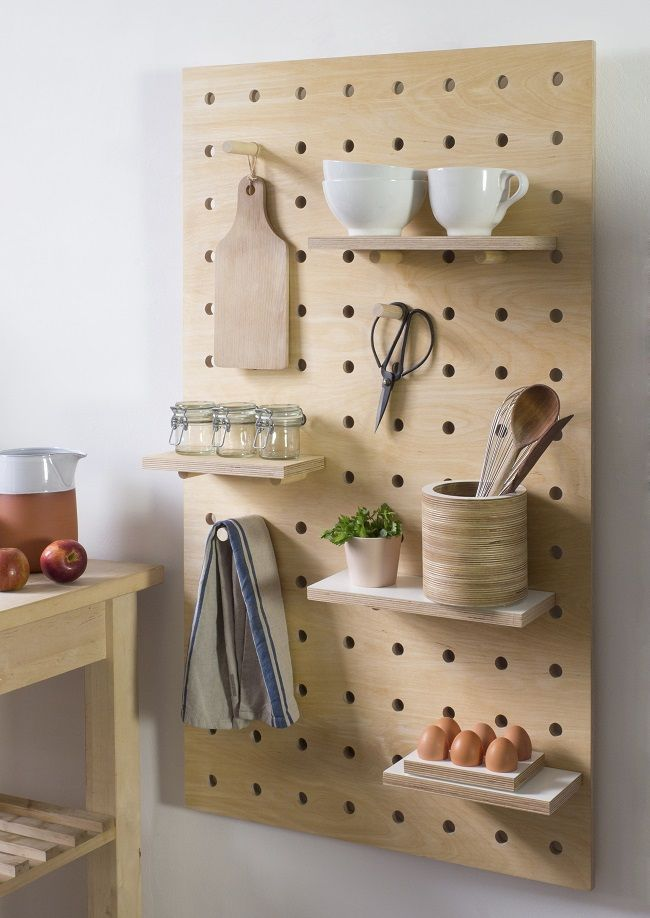 A pegboard design like this one, incorporating shelves makes organising your kitchen a doddle!