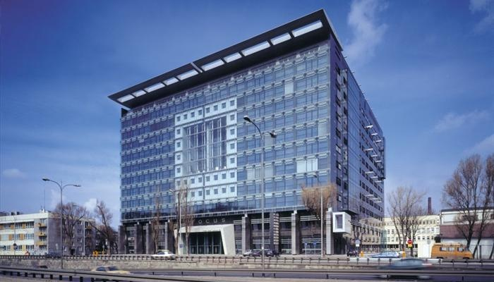 Focus building in Warsaw, Poland -  main façade constructed in the double-skin technology where the external skin is made of the Pilkington Planar™ structural glazing frameless system with transparent, thermally toughened partially silk-screen printed single clear float glass.